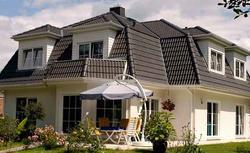 TREND: szare dachy. Poznaj kolory elewacji, które pasują do szarego pokrycia dachowego. ZDJĘCIA